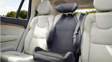 Padded upholstery for integrated booster seat